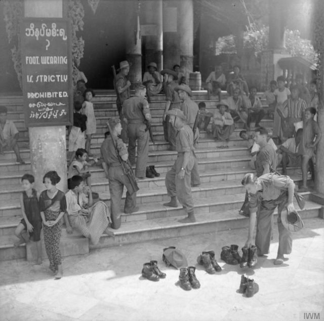 Soldiers remove their shoes at the Shwedagon Pagoda in Rangoon, 1945